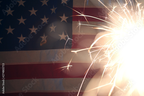 Canvas Prints Countryside Lit sparkler burning in front of American Flag