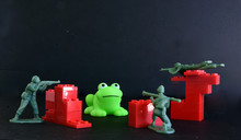 One Frog Three Toy Soldiers Wi...