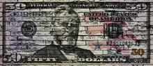 US Dollar Banknote On A Brick Wall