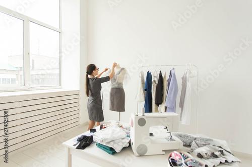 Fényképezés  Dressmaker, fashion designer and tailor concept - young fashion designer works i