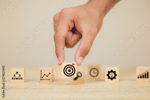 Hand of busines hold a target with arrow,stacking wooden blocks into steps,Conce Wallpaper Mural