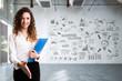 canvas print picture - junge Frau mit Handschlag-Geste vor leerem Büro mit Businessplan an der Wand