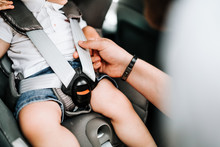Details Of Child Car Seat With Baby Inside, Seatbelt And Safety