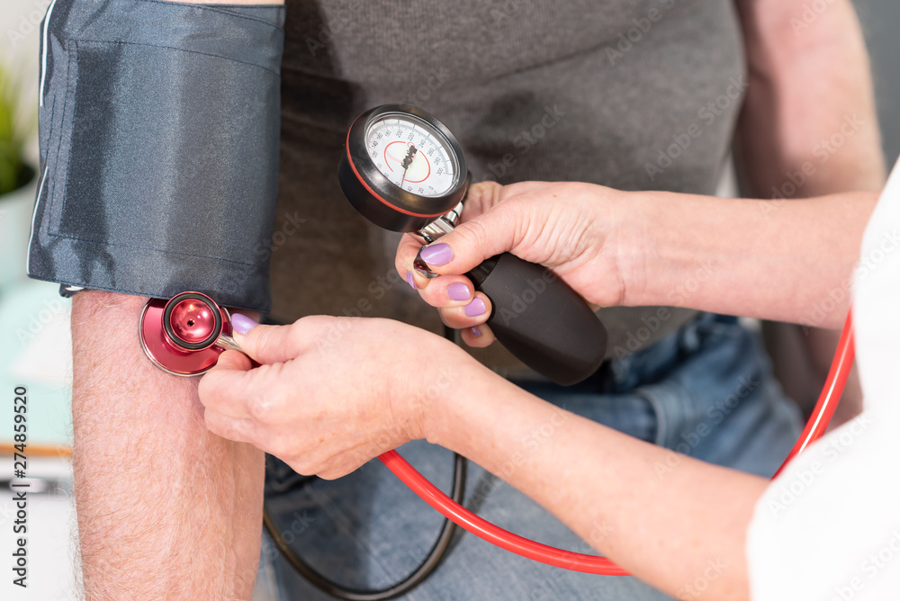 Fototapety, obrazy: Blood pressure mesuring with sphygmomanometer