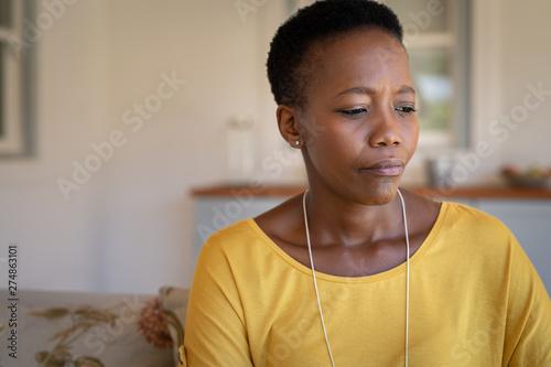Fotografie, Obraz  Sad mature black woman alone