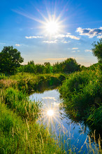 Blue Sky Over A Little Creek In The Surrounding Countryside Of Berlin, Germany.