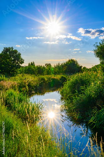 Blue sky over a little creek in the surrounding countryside of Berlin, Germany Poster Mural XXL