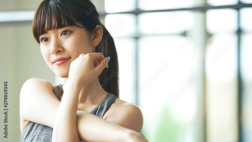 Fototapeta ストレッチする女性