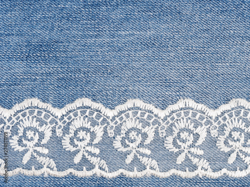 Photo  White lace on jeans background. Sewing still life