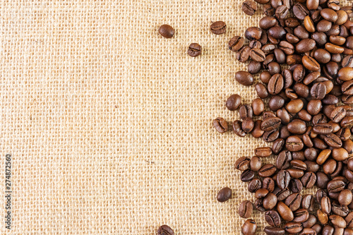 Foto op Plexiglas koffiebar Coffee beans on a background of burlap. Place for text. Concept of making coffee, coffees.