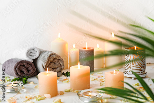 Fototapety, obrazy: Beautiful spa composition with burning candles and towels on table