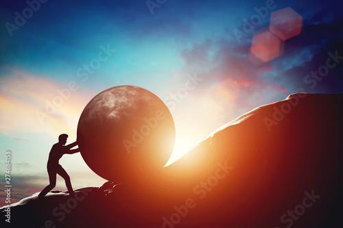 Obraz na plátně Man pushing huge concrete ball up hill.
