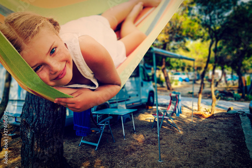 Obraz Camping RV travel with camper, summer beach. Happy smiling beauty girl on mototorhome vacation. - fototapety do salonu