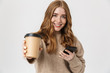 Attractive young girl wearing sweater standing isolated
