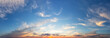 canvas print picture - Sunset cloudy sky with orange sun