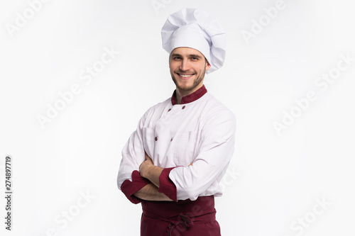 Portrait of positive handsome chef cook in beret and white outfit isolated on white background Billede på lærred