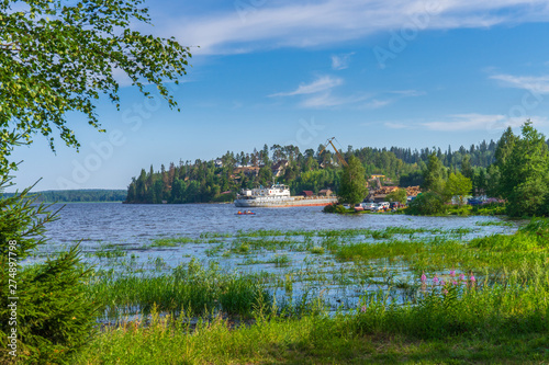 Fotografie, Tablou  Summer landscape with pier and small harbour in northern village