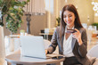 Asian businesswoman using credit card and mobile phone for online financial payment and shopping