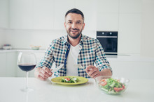 Portrait Of Charming Imposing Mature Guy Sit Table Hold Hand Fork Knife Want Cut Pleasant Evening Cheerful Checked Shirt Big Light Apartment Wineglass