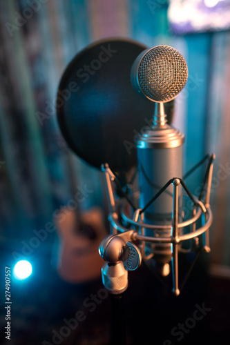 Studio recording microphone on a blur wood background voice