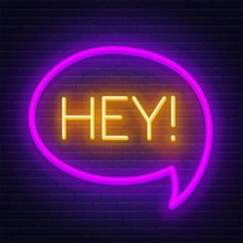Neon Sign Hey In Frame On Dark Background. Light Banner On The Wall Background.