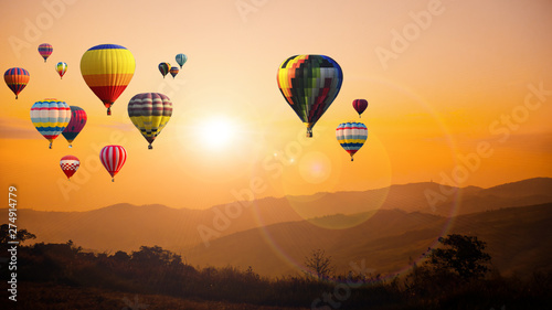 Poster Balloon Hot air balloon above high mountain at sunset
