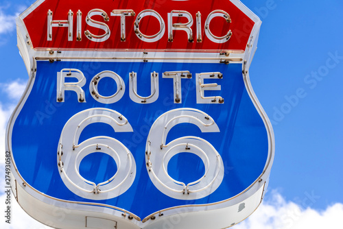 Photo  Red, white and blue neon sign on the famous, historic Route 66 in front of blue