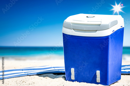 Poster Ecole de Danse Summer time on beach and free space for your decoration. Blue and white umbrella with landscape of ocean.