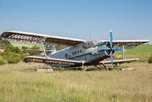 Abandoned Old Airplane On The Field