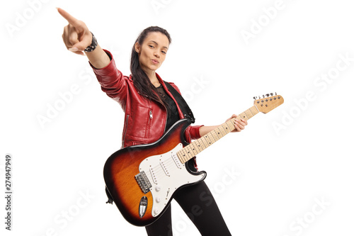 Young female musician with a bass electric guitar Fototapeta