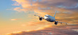 Leinwandbild Motiv airplane fly at Sunset clouds