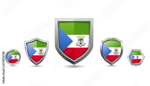 Fotografía set of equatorial guinea country flag with metal shape shield badge