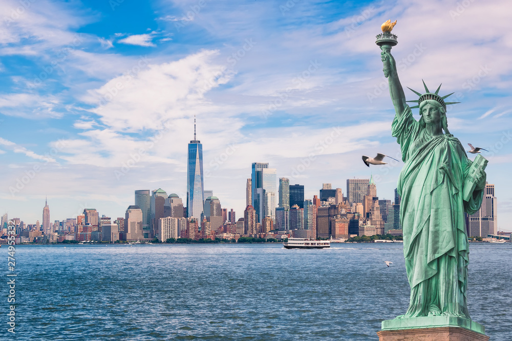 Fototapety, obrazy: Statue of Liberty in front of the Manhattan skyline, in new york city,USA, with seagulls and boats