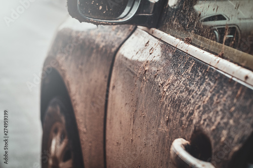 Obraz Closeup photo shoot of dirty car's mirror, door and window, splash and texture of mud on silver car. - fototapety do salonu