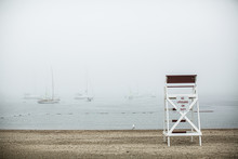 Foggy Day At The Beach With Lifeguard Chair