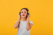 Happy Teenager Listening To Mu...