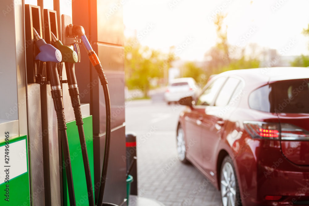 Fototapety, obrazy: Fuel pump and car on filling station