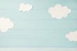 Leinwandbild Motiv Cute children or baby card, white clouds on the light blue wooden background, tonned