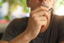 Man Enjoying Smoking Cigarette...