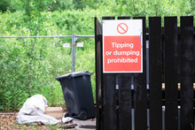 Flying Tipping Or Dumping Prohibited Sign And Bins