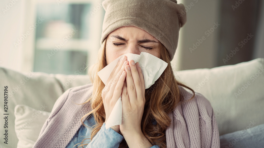 Fototapety, obrazy: Young woman suffering from cold