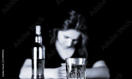 Poster de jardin Bar Drunk Woman At Bar Counter with a Bottle and a Glass of Whisky