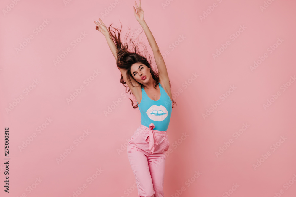 Fototapety, obrazy: Stunning girl posing with kissing face expression on pink background. Indoor photo of wonderful brunette young lady dancing in studio.