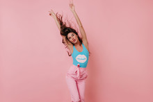 Stunning Girl Posing With Kissing Face Expression On Pink Background. Indoor Photo Of Wonderful Brunette Young Lady Dancing In Studio.