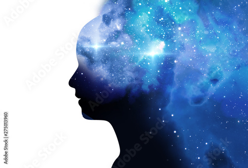 Fotografie, Obraz  silhouette of virtual human with aura chakras on space nebula 3d illustration