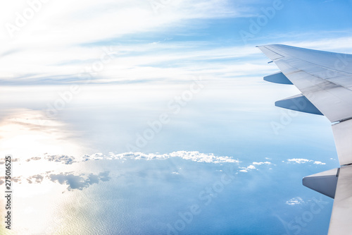 White airplane in blue sky with view from window high angle during sunny day wit Canvas Print
