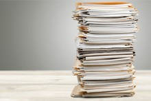 Stack Of Papers Isolated On Wh...