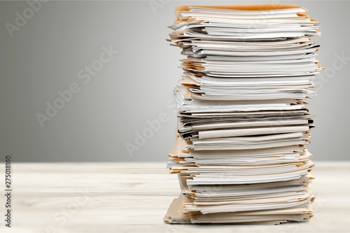 Leinwand Poster Stack of papers isolated on white background