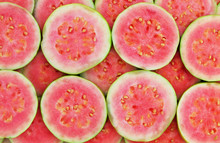 Slices Of Pink Guava As Background