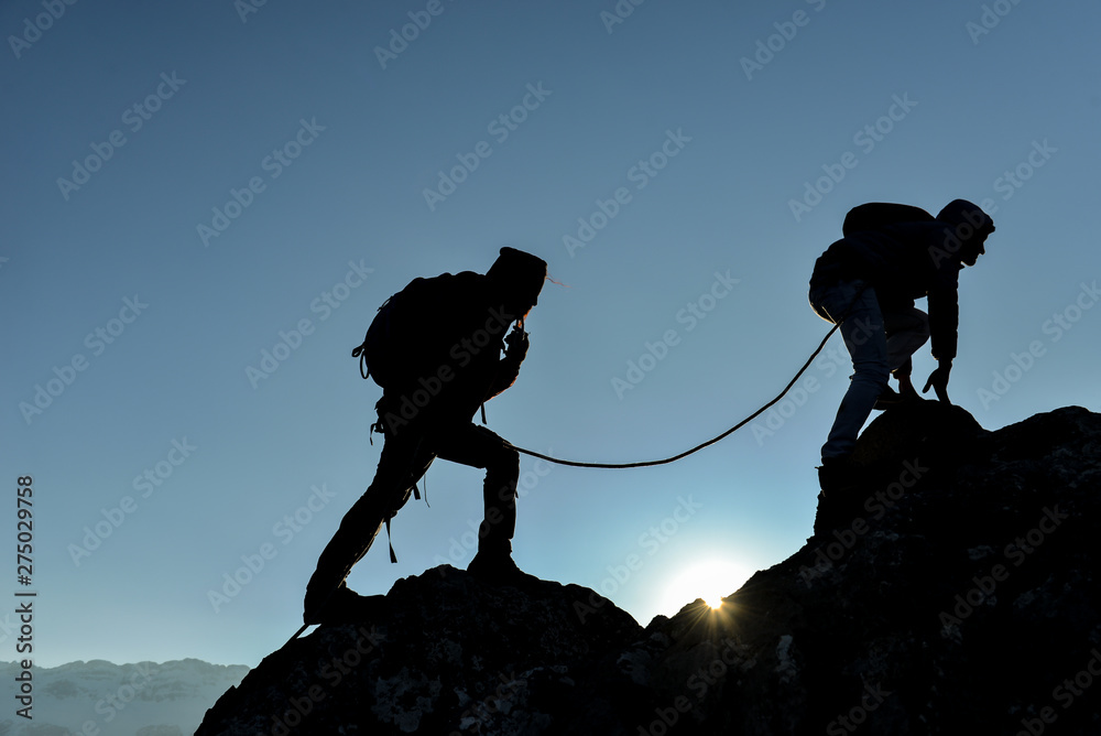 Fototapety, obrazy: concept of professional two climbers crossing the cliffs